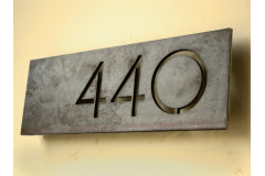 Industrial house numbers, flat designation or company name and restaurant